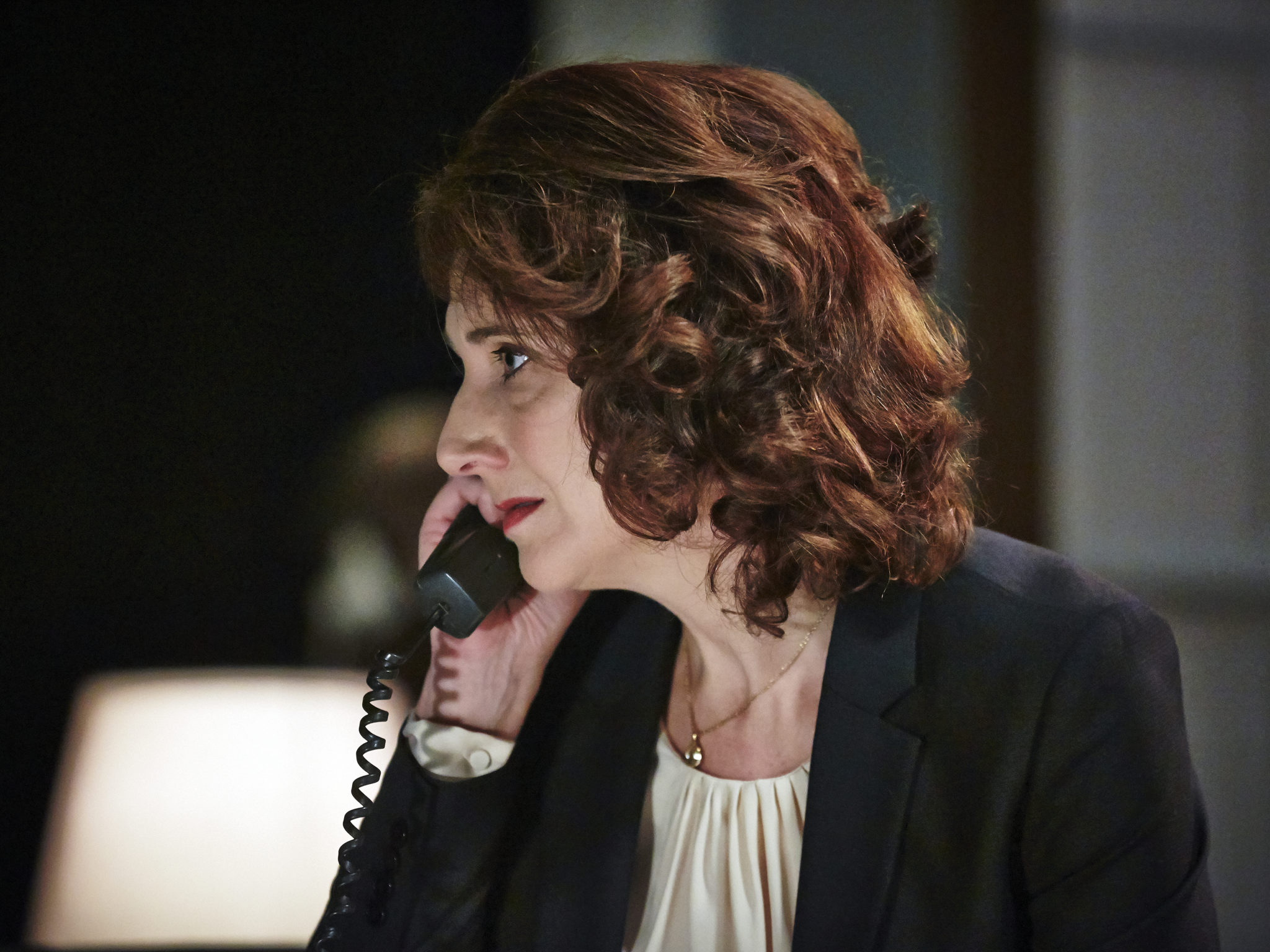 Ali White as The Advisor in The Bailout