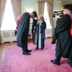Lenny Abrahamson records Dr Annie Doona,President Dun Laoghaire Institute of Art, Design and Technology as she helps Bressie gown up for the ceremony. Pics Brian Farrell
